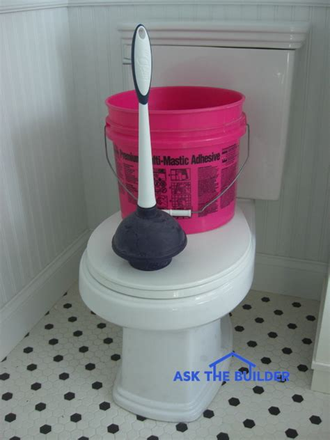 blocked waste pipe bathroom clogged toilet fixed with a bucket of water it really