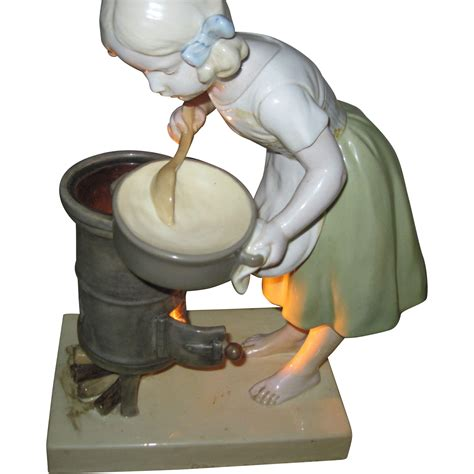 porcelain doll buyers beautiful porcelain l light cooking at stove for