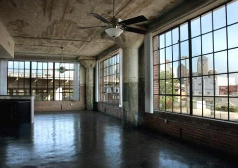 big loft big windows concrete columns shiny floor i dig it warehouse loft columns