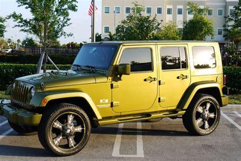 matte lime green jeep kmc vandal matte black wheels in a lime green jeep