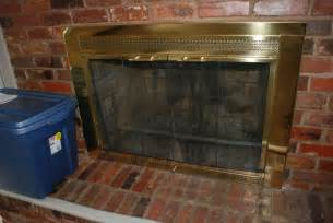 vintage basement ideas with polished brass fireplace doors