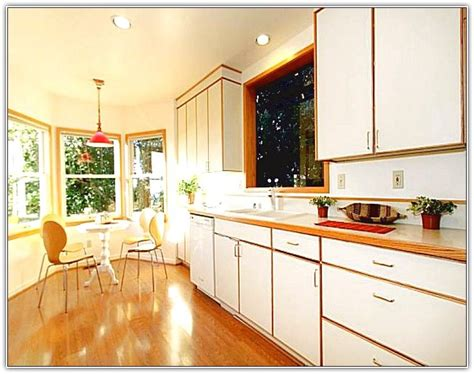 White Kitchen Cabinets With Wood Trim by White Kitchen Cabinets With Stained Wood Trim Kitchen