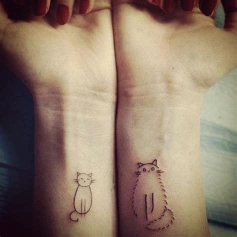 cat wrist tattoo two simple drawings of cats become wrist tattoos