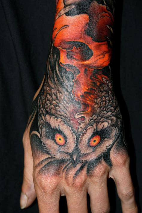 owl hand tattoo skull owl by jeff gogue tattoos