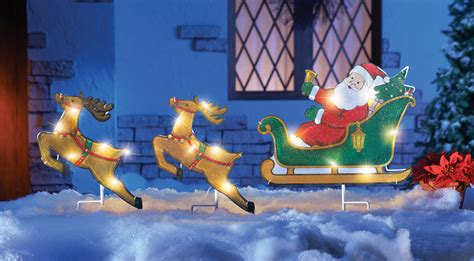 lighted santa sleigh and reindeer outdoor garden stakes