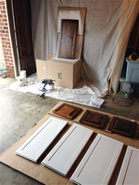 Spraying Kitchen Cabinet Doors Painting Our Cabinets White House