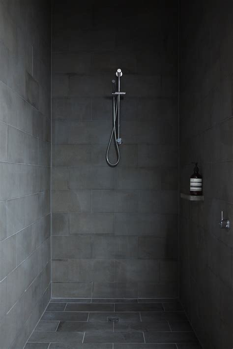 dark tiles bathroom minimalist house with pivoting wall and unusual details