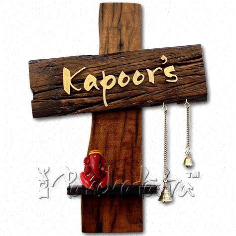 buy karigaari wooden family name plate on amazon wooden name plate designs for home www pixshark com