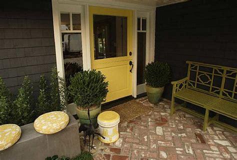 gray house yellow door yellow front door