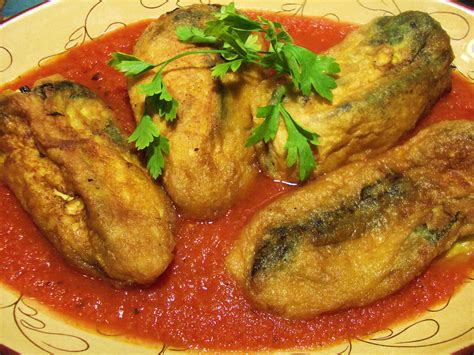 chiles rellenos poblano chiles stuffed with cheese and served with tomato sauce a mexican