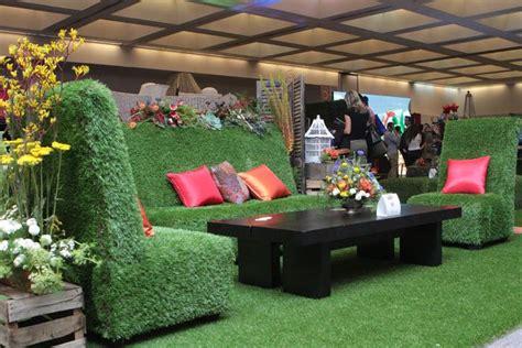 bizbash la ideafest  event design  rental ideas   show floor grass furniture