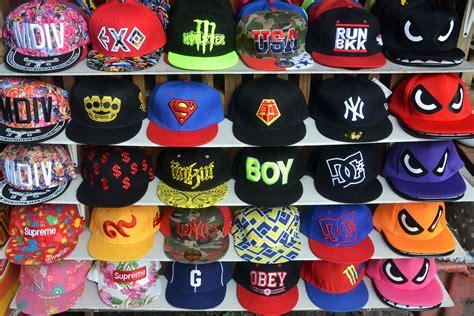 Thanksinsomnia Caps colorful hats in a row on a shop shelf 4k ultra hd