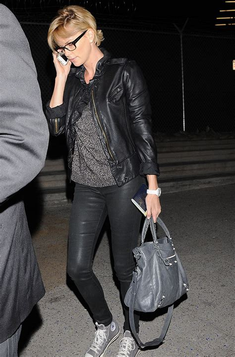 Charlize Theron With And Balenciaga Purses the many bags of charlize theron waysify top picks for