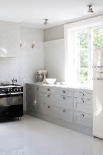 white and grey kitchens dove grey cabinets white subway tile kichens