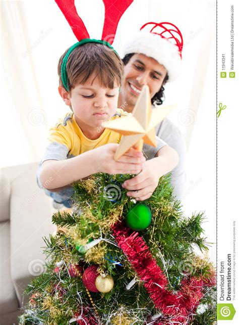 where to put a christmas tree with a fireplace the boy put a on the top of a tree stock image image of cheerful