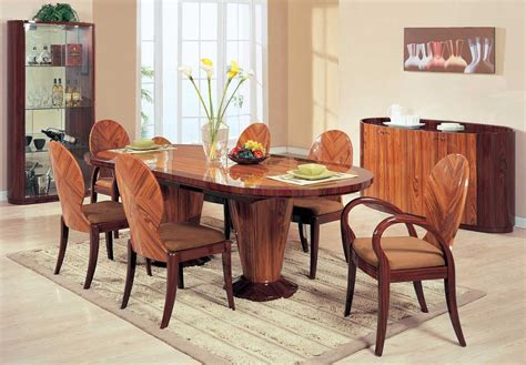 solid wood cherry oval kitchen table with modern wood chairs and area rug artenzo