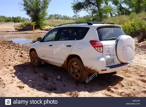 toyota suv usa toyota rav4 suv contemplates mud at a flooded of road