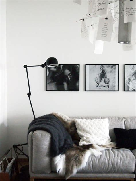 how to hang wall hangings above a sofa or bedroom