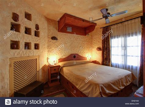 bed spanish wooden canopy above bed in spanish bedroom with vase
