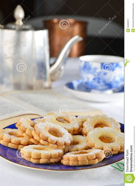 Delcious Yam Cookies delicious jam cookies with cup of tea stock image