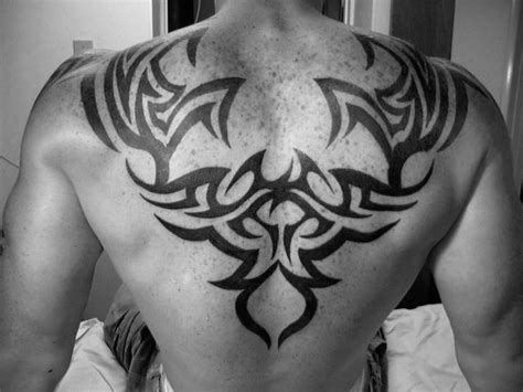 tribal tattoo upper back 60 tribal back tattoos for bold masculine designs