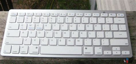 Keyboard External Macbook apple mac mini c w external drive wireless keyboard and mouse and books photo