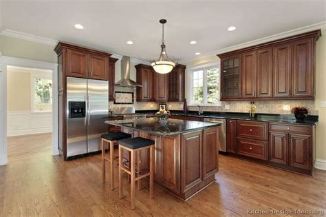 Kitchens With Cherry Cabinets And Wood Floors Quot Traditional Tuesday Quot Kitchen Of The Day Beautiful Cherry Cabinets Hardwood Floors Black