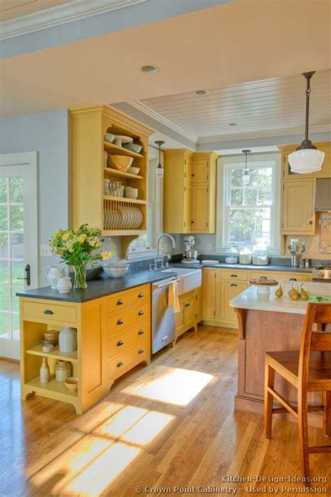 kitchen decorating ideas colors traditional yellow kitchen with a custom wood island