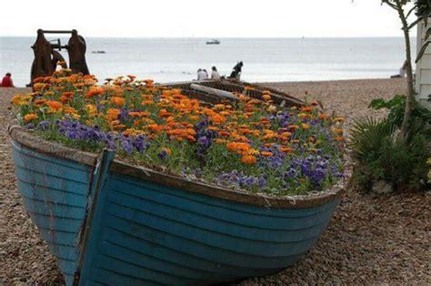 row boat planter outdoor gardens