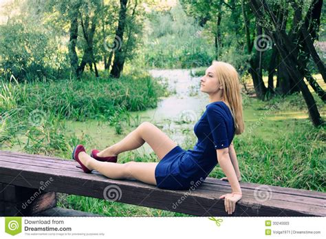 bench girl the girl on a bench stock photos image 33240003