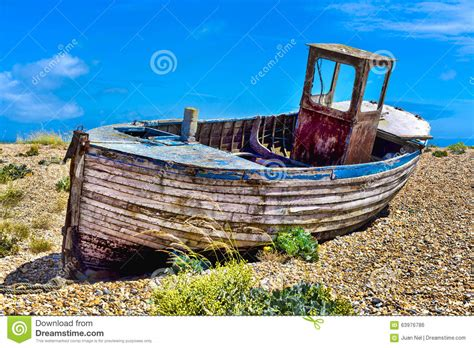 pebble art fishing boat old wooden fishing boat stock photo image 63976786