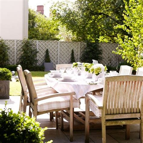 country style patio with table and chairs summer party