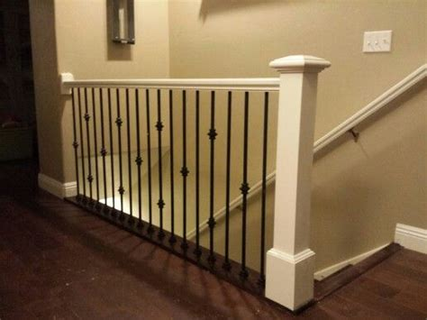 antique white railing and post with black iron balusters