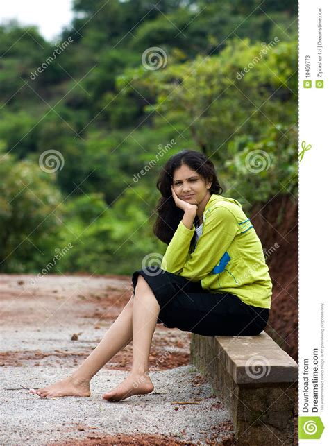 girl sitting on a bench girl sitting on side bench stock photos image 10456773