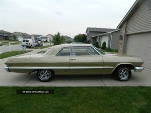 1963 chevy impala anniversary gold