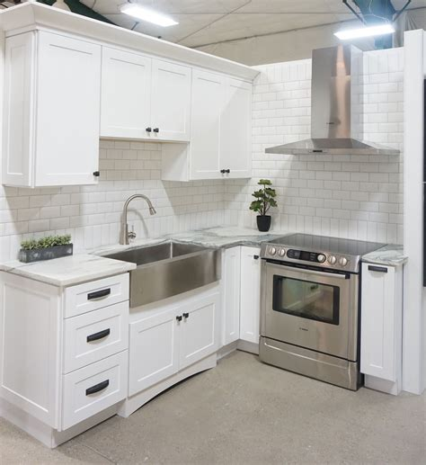 White Kitchen Farmhouse Sink White Cabinets Shaker Door Style White Marble Countertops White Bevelled Subway Tile