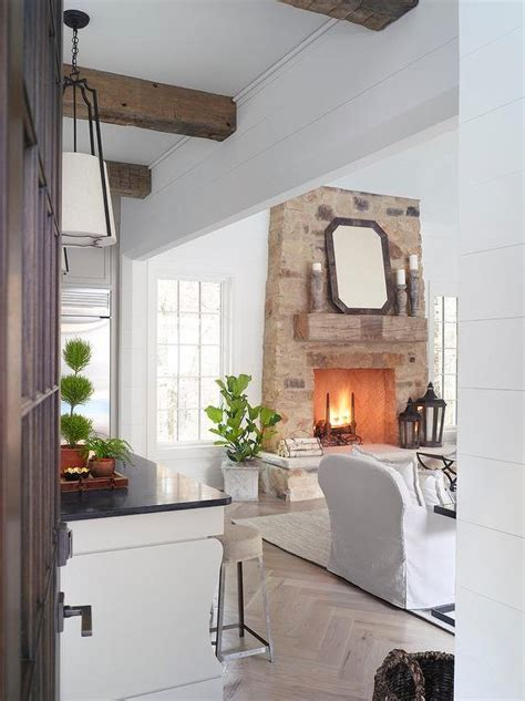 rustic fireplace mantle  stone fireplace transitional living room