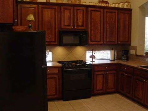 Black Kitchen Cabinets With Black Appliances Black Appliances With Oak Cabinets Do You Like The Ss Or Black Better In My Kitchen Kitchen