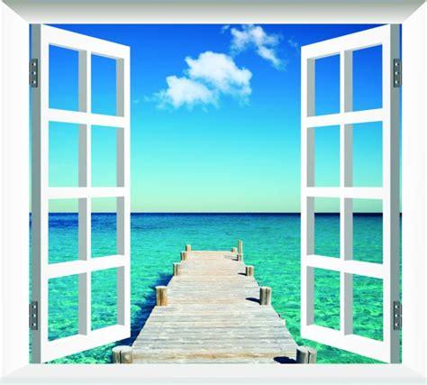 la ciudad con ventanas fotomural decorativo ventana con vistas a una pasarela en la playa fotomuraldecorativo