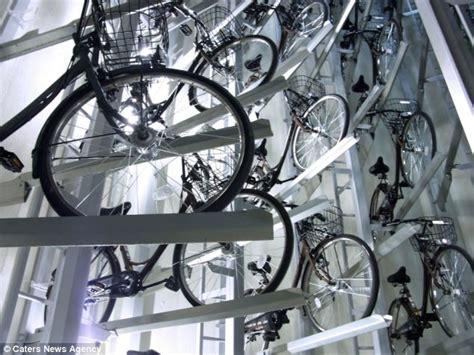 japanese bike rack tokyo s underground cycle rack holds 200 bikes below the