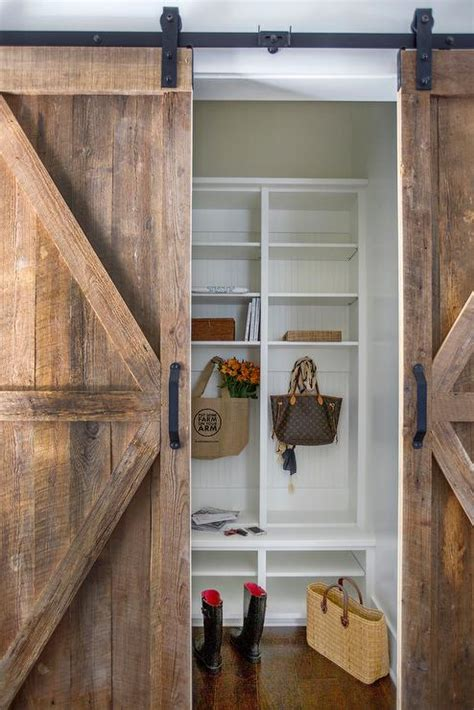 barn wood door mudroom with barn wood sliding door cottage laundry room
