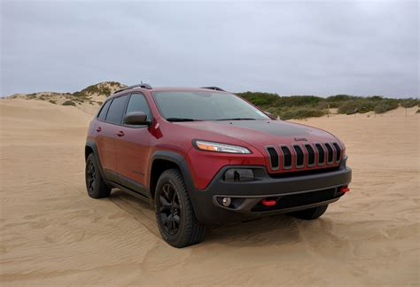 jeep cherokee trailhawk green storming the beach with the 2016 jeep cherokee trailhawk