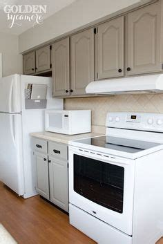 white appliance kitchen painted kitchen cabinets using paris grey chalk paint by