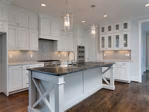 Soapstone Island Countertop by White Kitchen Cabinets With Gray Chevron Tile Backsplash