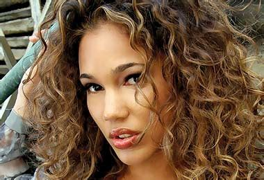 short curly brown hair with highlights blonde highlights on dark brown curly hair celebrity