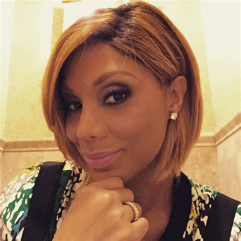 tamara braxton hairstyle do or don t tamar braxton sports bangs and loose waves