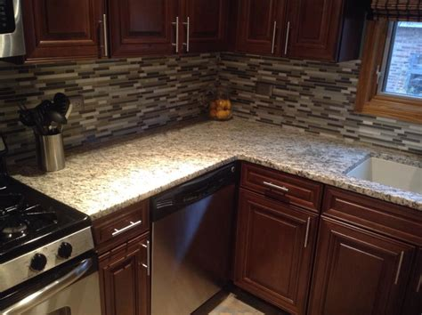 dark kitchen cabinets with light granite countertops giallo ornamental light granite kitchen with cabinetry