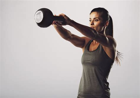 kettlebell swing fat loss 9 kettlebell workouts to lose weight popsugar fitness