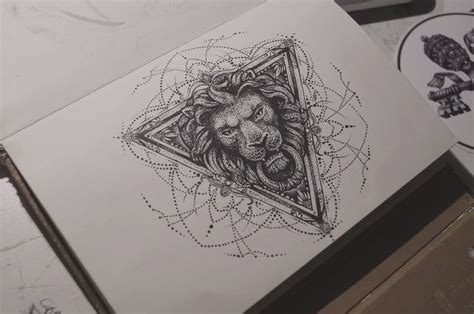 dotwork lion keeping a ring in triangle frame tattoo