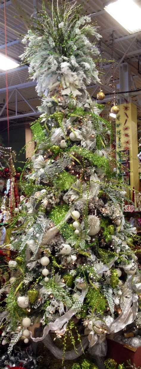 snow white and lime green decorated christmas tree